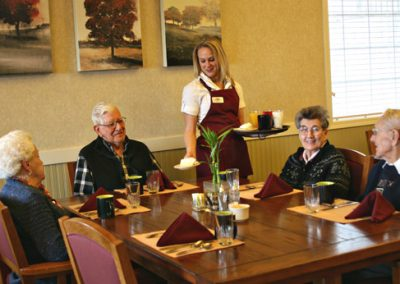 happy_seniors_being_served_meal